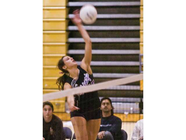 Valencia High's Shelby LeDuff spikes a kill in the first game of a match against Golden Valley Tuesday at Valencia. The win, coupled with Saugus' victory over West Ranch gives the Vikings the title.