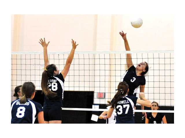 Saugus High's Kacie Crawford (No. 3) with a spike on Tuesday.