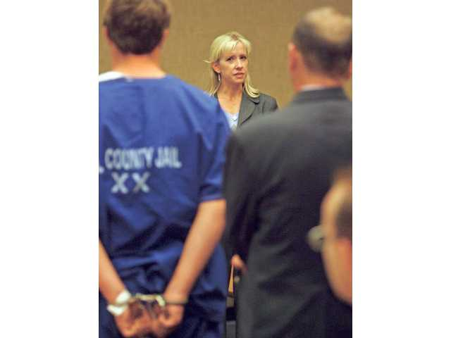 Joan Hayes-Rennels, mother of Valencia High School senior Megan Hayes, confronts Jason Halliday, in blue, at the Santa Clarita Courthouse on Nov. 5 during Valencia High School's Every 15 Minutes Program.