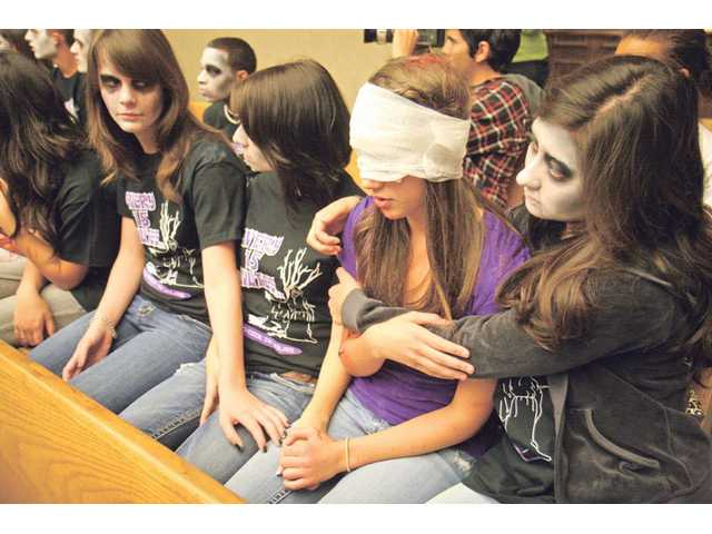 Chelsea Itaya, far right, comforts Megan Hayes, in purple, during Halliday's mock trial at the Santa Clarita Valley Courthouse. For a whole day, students and parents participated and witnessed the mock consequences of drunk driving.