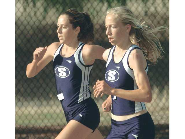 Saugus' Kaylin Mahoney, left, and Karis Frankian run stride for stride at Central Park on Thursday.
