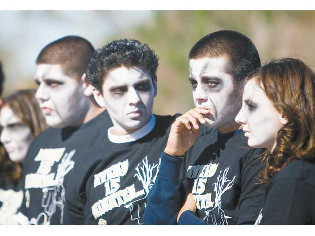 "Golden Valley High School students, playing the roles of the walking dead, console each other during the ""Every 15 Minutes"" event Thursday afternoon."
