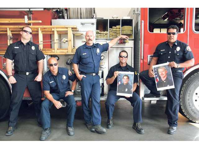 From left to right, Station 107 Fire Captain Al Bustillos, Bradley Yocum, Brian Clayton, Tom Tobin and Chris Mangarin, along with other firefighters will hold a fundraiser for the families of Captain Tedmund Hall and Specialist Arnaldo Quinones, firefighters who died in the Station Fire.