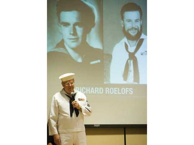 Richard Roelofs, 87, talks to a group of Canyon Springs Elementary School students about his life in the U.S. Navy. The school's Student Affairs Organization honored and awarded medals of citizenship as well as letters to a group of local veterans.