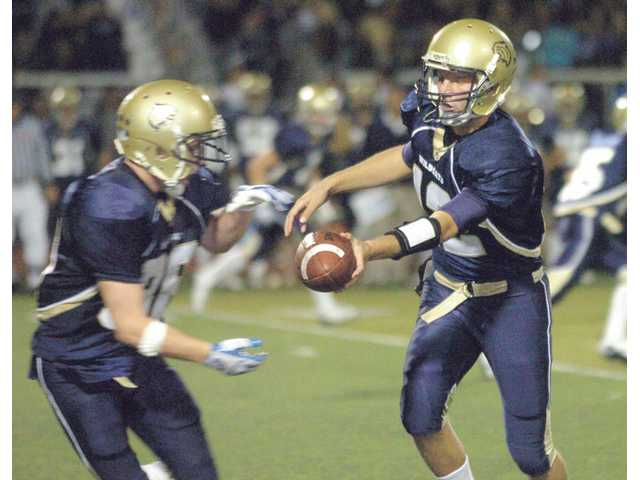 West Ranch running back Zak Snell, left, takes a handoff from quarterback Connor Eichten last Friday at Valencia High against Hart. Eichten threw for 310 yards and Snell rushed for 125 in the game.