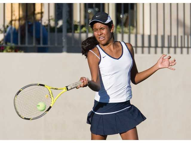West Ranch senior Ana Lucia Fuentes hits a forehand volley Thursday at Paseo Club.