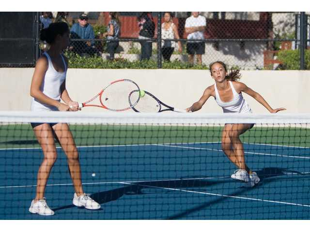 Twin sisters Clarice and Emily Fraczek, above, took home the Foothiull League doubles title with a 6-0, 6-2 victory over another set of siblings, Gavelynn and Lena Poonnopatam of West Ranch.