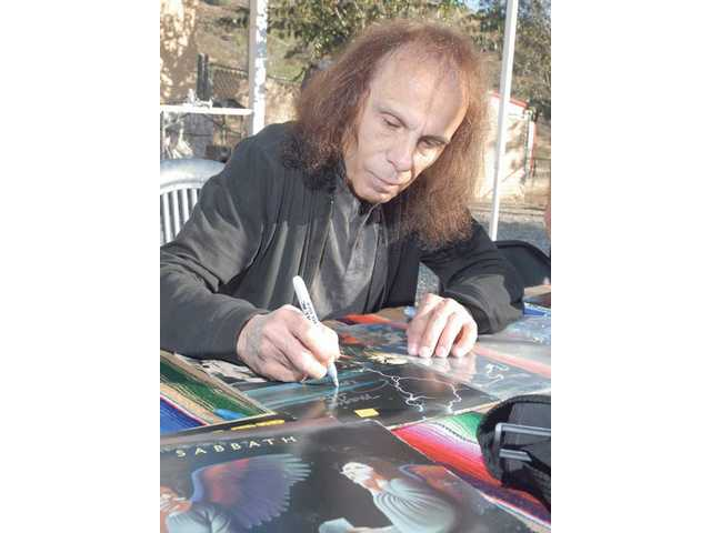 "Heavy metal singer Ronnie James Dio signs memorabilia at the ""A Day in Their Paws"" fundraiser for The Brittany Foundation in Agua Dulce on Saturday. The event's goal was to raise awareness on the plight of shelter dogs."