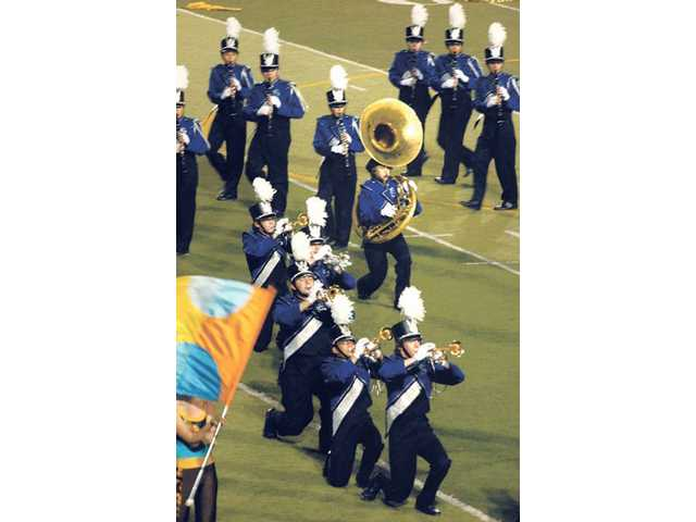 "Saugus High School's Marching Band and Color Guard performs ""Journey of Delight"" at Hart High School's 26th annual Rampage Field Show Tournament held at College of the Canyons on Saturday."