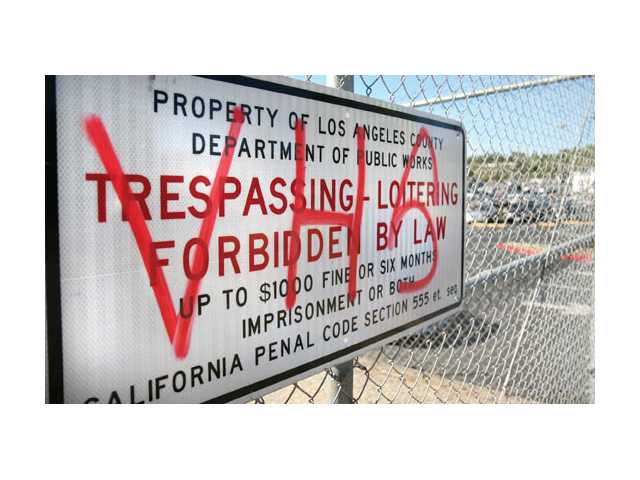 A sign near Saugus High School was vandalized the night before a big football game with rival Valencia High School.