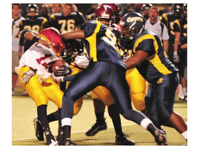 The College of the Canyons defense stops Pasadena quarterback Eldrin Jones,