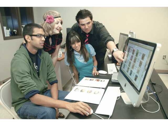 Peter Yahiayan, 17, right, points to one of his T-shirts available as he and company officers, from left, Galen Flynn, Erin Wallerstein and Roxy Cardenas discuss the product catalog at Golden Valley High School's virtual entrepreneur class on Tuesday.