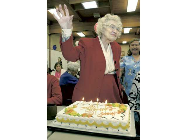 Valencia resident Julia Jay gives a wave of thanks to those who celebrated her 100th birthday at the Santa Clarita Valley Senior Center in Newhall on Thursday.