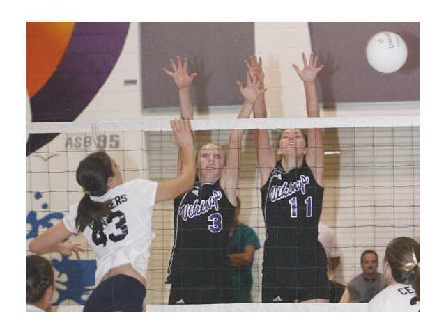 West Ranch's Alison Summers battles of Christina Worth (3) and Nicole Delange (11) of Valencia at an early league showdown between the area's top two volleyball squads.