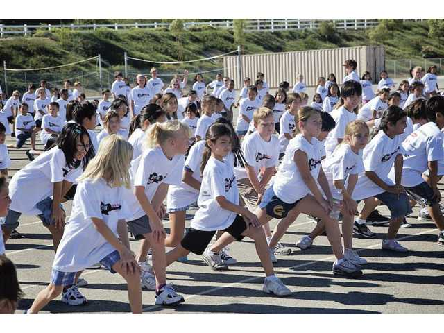 Oak Hills Elementary School students stretch and get ready for the Jog-a-Thon fundraiser held in October.
