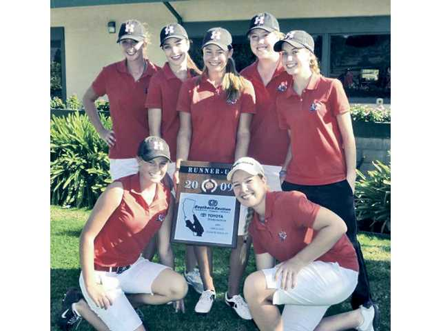 The Hart High girls golf team poses with the runner-up plaque at the CIF-Southern Section Final on Monday in Pomona.