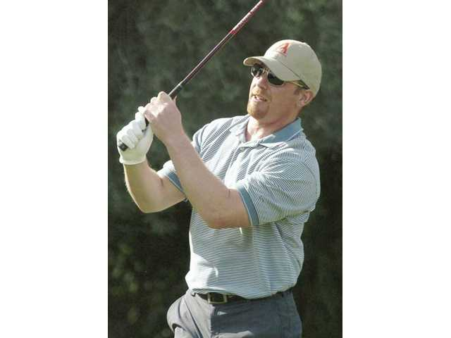 Los Angeles Dodgers pitcher Randy Wolf tees off on the first hole Monday at Valencia Country Club in a charity golf tournament benefiting the Greater Los Angeles Chapter of the ALS Association.