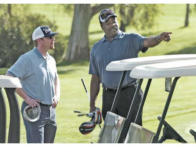 Dodgers pitcher Randy Wolf, left, chats with Major League Baseball Hall of Famer Eddie Murray at an ALS fundraiser Monday at Valencia Country Club.