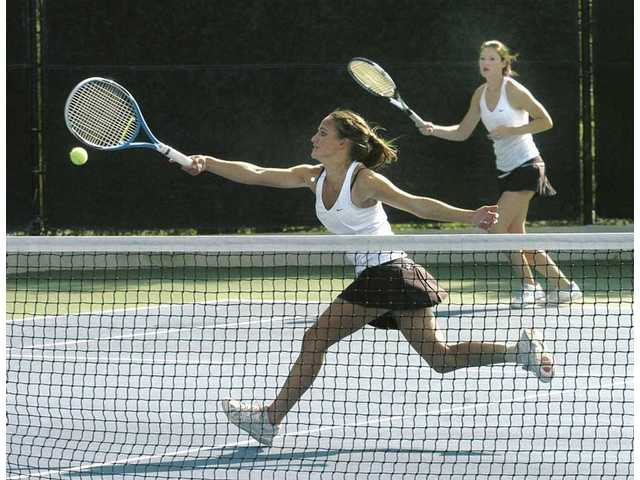Valencia's doubles team of Andrea Zammit, front, and Chelsea Dietz compete at the Foothill League prelims on Nov. 5 at Paseo Club.