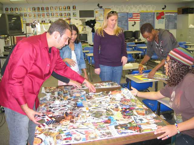 Bowman High School students Luis Victorio, Buster Robertson and LaNees Gerguson put a puzzle together for Mix It Up Day while Stacey Weatherman and Rosa Villanueva supervise.
