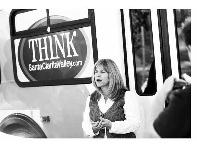 "Santa Clarita City Councilwoman Laurie Ender talks about the success of the ""Think Santa Clarita Valley"" campaign Tuesday morning outside Bristol Farms. ""It's starting to reach the average citizen,"" she said. ""If you stay here, we all win."""