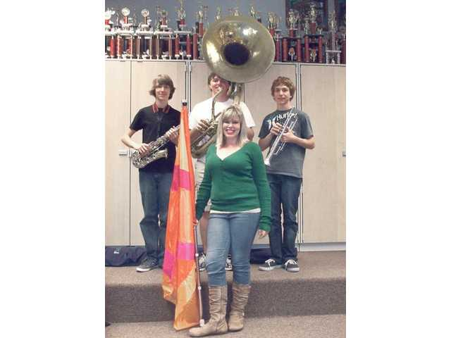 Saugus High School students Thomas Callier on trumpet, Aaron Huffman on tuba, Michael Taylor on alto saxophone and color guard member Akaila Ballard will march in the upcoming Tournament of Roses.