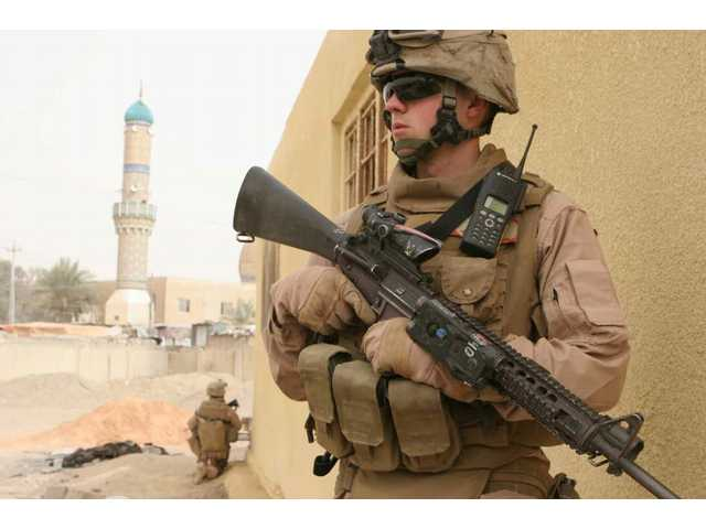 U.S. Marines with Company K, 3rd Battalion, 5th Marines (3/5), Regimental Combat Team 1 (RCT-1) secure a schoolyard during a patrol in the Andaloos district of Al Fallujah, Iraq on Jan. 29, 2008.