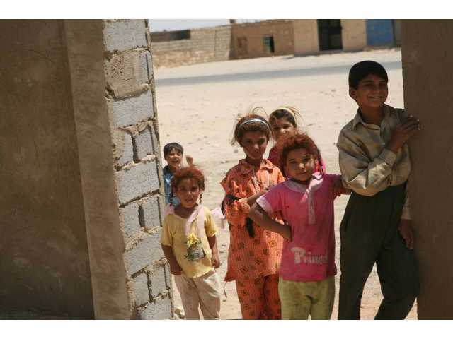 Children from the Abu Saleh area of Fallujah play together July 5, near the school they attend during the school year. The school is being rebuilt as part of a humanitarian aid project run by the Marine Corps and the Iraqi administration of education.