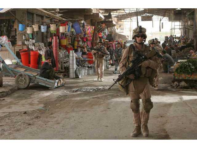 A U.S. Marine with Company K, 3rd Battalion, 5th Marines (3/5), Regimental Combat Team 1 (RCT-1) patrols the Andaloos district of Al Fallujah, Iraq on Jan. 29, 2008.
