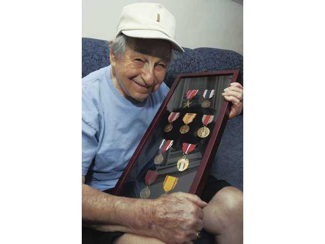 World War II prisoner of war Donald Persens, 85, of Saugus, proudly displays some of the medals he earned during his time in the service.