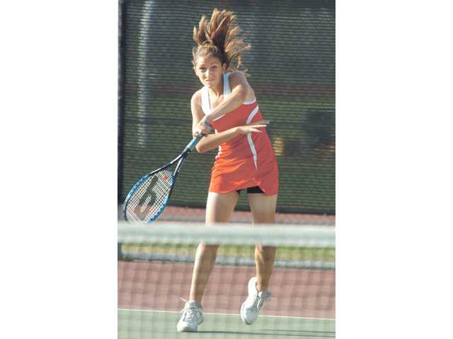 Hart High tennis player Victoria Lionetti returns a volley against Righetti Tuesday at Hart High.