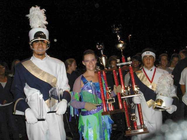 West Ranch High School Drum Major Josef Staley, color guard Captain Amy Haendle and Drum Major Ronnie Sunna hold the sweepstakes awards for all categories at the Nov. 1 Hart Rampage competition.
