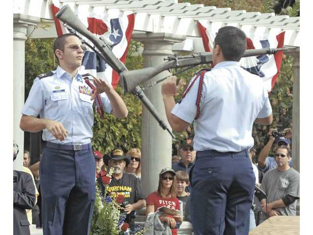 Valencia High School Junior ROTC Exhibition Rifle Team members Patrick Dunkel, left, and Kelvin Ulloa perform for the crowd during Veterans Day ceremonies at Veterans Historical Plaza in Newhall on Wednesday.