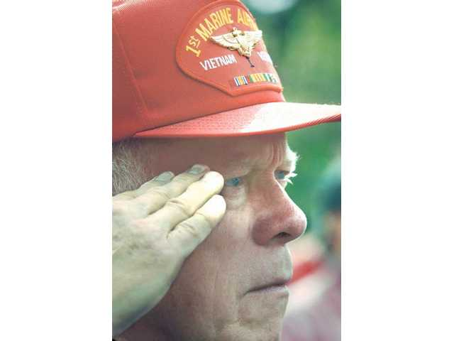 U.S. Marine Corps Vietnam veteran Robert Scobie salutes during the National Anthem at the third annual Veterans Day Ceremony held at Veterans Memorial Plaza in Newhall on Wednesday.