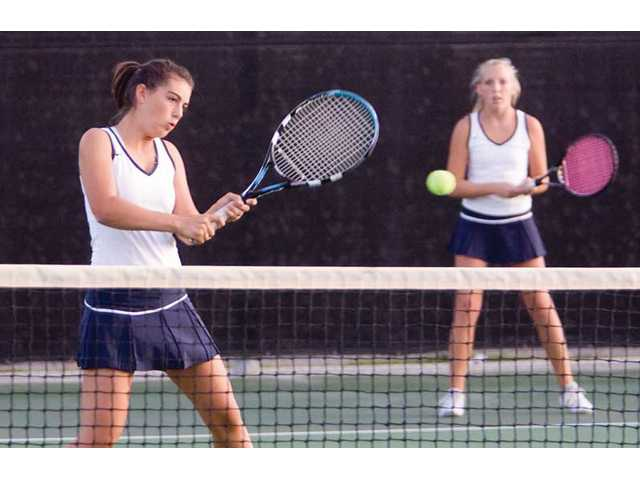 West Ranch High's No. 1 doubles True O'Neill returns the ball to Paso Robles opponents as teammate Mallory Martin watches.