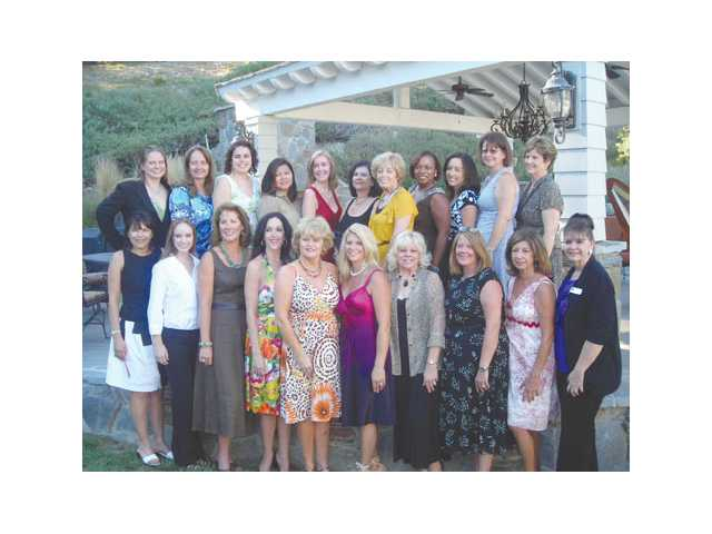 The women of the Henry Mayo Newhall Memorial Hospital Health Foundation Guild at the recent Silver Rose Debutante Tea. Back row, left to right: Shawnie Wise Hawkins, Sunny Wise, Mary Montoya, Jenn O'Hara, Linda O'Hara, Phyllis Grekin, Lucille Bowman, Verna Velasquez, Deborah Weyand, Terrie Cipriano. Front row, left to right: Rosemary Chavez, Marie Wise Hawkins, Betsy Linn, Shelley Hann, Cathy Montoya, Kristine Crowder, Eva Murray, Virginia Hart, Mary McCormick and Susan Beesley. The Guild raises money to support various services at Newhall Memorial hospital. Among the Guild's annual events are the Silver Rose Debutante program, Silver Rose Debutante Ball and the annual Guild Fashion Show. Silver Rose Debutantes will be on hand at the Community Tree lighting Dec. 6 on the Henry Mayo campus.