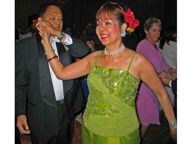 Oliver and Nayda Carreon dance at the Filipino-American Association of Santa Clarita Valley Silver Anniversary Ball at the Hyatt Valencia.