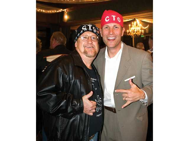 "TimBen Boydston, left, and John Dow channel their ""biker"" alter-egos to honor Harte."