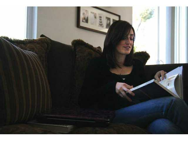 Twenty-seven-year-old Stephanie Magness sit in the family room of her Saugus home doing homewrok for one of her college classes. Although diagnosed with Freidreich's Ataxia four years ago, Magness has made sure tohold numerous fundraisers to collect money for the research of this rare disease she lives with.Four years ago Magness was diagnosed with Freidreich's Ataxia  a fundraiser to raise money for research