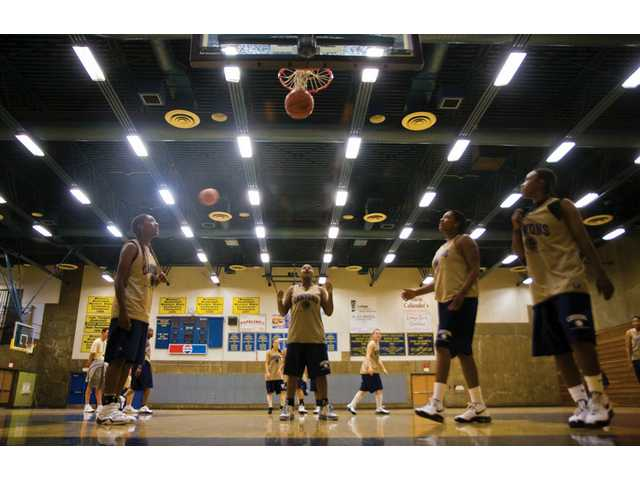 The College of the Canyons women's basketball team runs drills at its practice Wednesday night in preparation for its game tonight against Pierce College. The Cougars may have their most athletic team in several years.