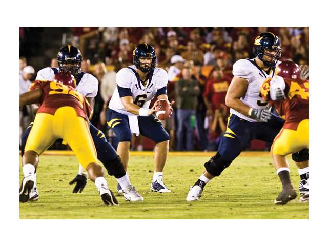 Golden Bears' quarterback and Canyon High product, Nate Longshore takes a snap in their Nov. 8 meeting with USC at the Coliseum. Longshore battled through personal tragedy and injuries during his career.