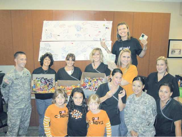 Members of the United States armed forces accept 622 pounds of candy turned in by children of the Santa Clarita Valley at the dental offices of Allen Smudde, D.D.S. and Kelly Smudde, D.D.S. The candy will be sent overseas.