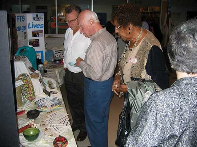 Some attendees of St. Stephen's Episcopal Church stroll through a small preview display of the Alternative Gift Fair to be held from 10 a.m. to 3 p.m. today and from noon to 3 p.m. Sunday.