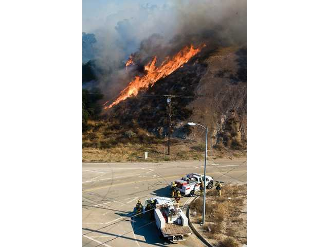 The Sayre Fire enters the Newhall Pass Saturday,shutting down Interstate 5 and Highway 14.