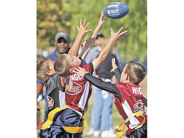 During Super Bowl Saturday, players from the Cardinals and the Bengals play against one another in the last game of the season at Central Park in Saugus.
