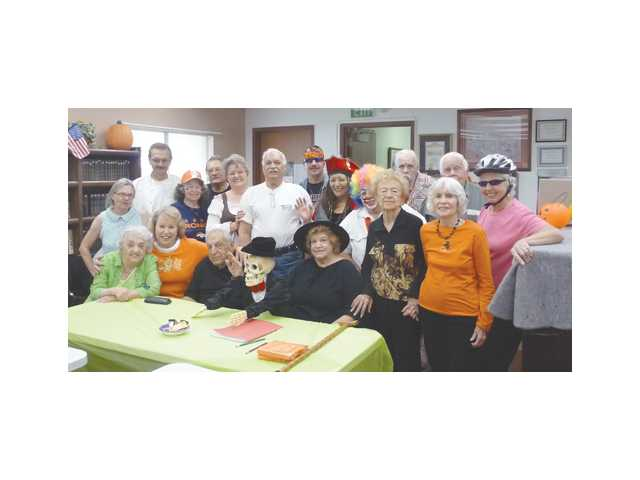 The Live, Love and Laugh support group celebrates Halloween at the SCV Senior Center.