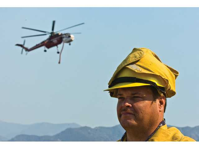 Brent Bollar, a Los Angeles County Fire Department volunteer photographer, spent Monday snapping pictures of the Sayre Fire near Placerita Canyon Road.