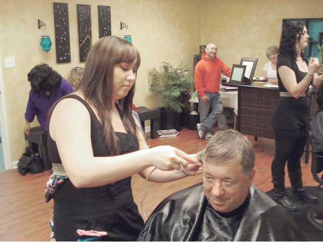 Members of Salon Zen and Friends and Family for a Cure hosted a cut-a-thon to raise money to fight cancer. The event raised more than $900 for the American Cancer Society. Patrons paid $25 for a shampoo, haircut and a styledry with all proceeds donated to the cause.