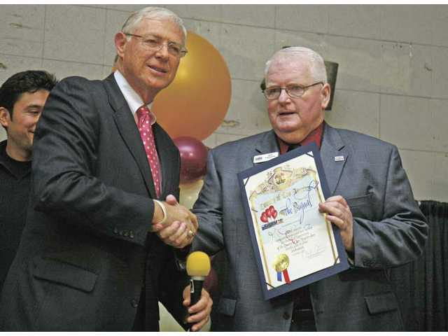 Los Angeles County Supervisor Michael D. Antonovich, left, presented a certificate of recognition to Signal Publisher Ian Lamont for the newspaper's nine decades of service Wednesday night, Nov. 18, 2009.