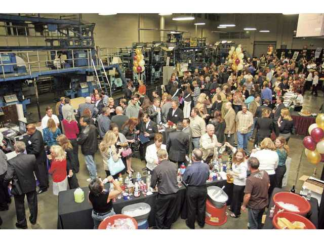 The more than 450 people who turned out Wednesday evening, Nov. 18, 2009, for a Santa Clarita Valley Chamber of Commerce mixer hosted by The Signal helped the newspaper celebrate its first 90 years of service to the SCV.